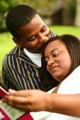 African American Couple Reading Book Outdoor poster