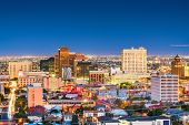 El Paso, Texas, USA  downtown city skyline at dusk with Juarez, Mexico in the distance. poster
