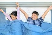 Children Are Stretching In Bed After Waking Up, Lazy And Good Morning World Concept poster