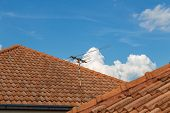 Roof Top On Sky Background. Close Up Of Brown Clay Roof Tiles. Red Old Dirty Roof. Old Roof Tiles. C poster