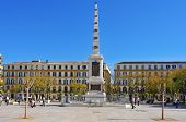 MALAGA, SPAIN - MARCH 13: Plaza de la Merced on March 13, 2012 in Malaga, Spain. In this square, one of the main squares in the center of the city, there is the obelisk in honor of General Torrijos