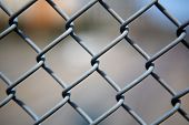 Narrow Dept of Field close up image of chain link fence
