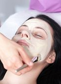 Woman getting a facial with cream