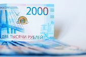 New Cash Banknotes Of Russia On A White Background. The Face Value Of The Banknote Is 2000 Rubles. T poster
