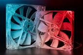Two Computer Fans Are Covered With A Thick Layer Of Dust On A Dark Background In The Light Of Bright poster