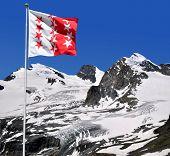 Strahlhorn,Rimpfischhorn and Allalinhorn with Wallisflag - Swiss Alps