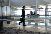 businessman walking through airport