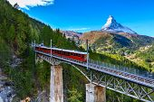 Zermatt, Switzerland. Gornergrat Red Tourist Train On The Bridge And Matterhorn Peal Panorama In Swi poster
