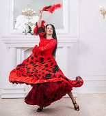Attractive Female Dancer With Fan Performing Flamenco poster