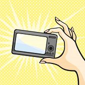 Illustration of a female hand holding a photo camera