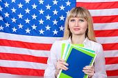 Young woman on the background of the flag of America