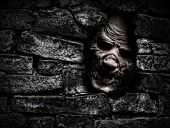 foto of crippled  - Horror monster looking out from hole in the wall - JPG