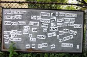 picture of stockade  - Old metal board with a jumble of words covering it - JPG
