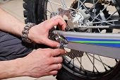 Motorcycle Wheel Repair After Tire Leaks Or Disc Damage. poster