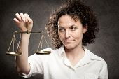 Businesswoman holding Justice scale