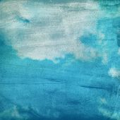 clouds on a textured paper background