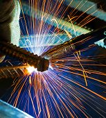 Welding With Sparks By Process Fluxed Cored Arc Welding , Industrial Steel Welder Part In Factory We poster