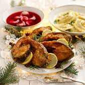 Christmas Carp, Fried Carp Fish Slices On A White Plate On A Holiday Table, Close Up. Traditional Ch poster