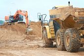 pic of boom-truck  - wheel loader excavator machine loading dumper truck at sand quarry - JPG
