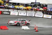 KUALA LUMPUR - MAY 20: Max Orido (red/white RSR) accelerates on the wet tarmac during the Formula Dr
