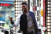 NEW YORK-MAY 18: Singer Usher performs on the Today Show concert series at Rockefeller Plaza on May