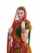 Bollywood dancer in traditional beautiful orange dress with veil