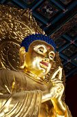 Close Up Of A Golden Buddha Statue In Jing Shan Park (beijing). Above The Statue Is A Ceiling With T poster