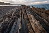 Coast Landscape Of Famous Flysch In Zumaia, Basque Country, Spain. Famous Geological Formations Land poster
