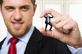 stock photo of torture  - Big businessman crushing a small one - JPG