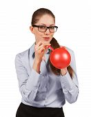 Woman With Glasses Inflating A Rubber Balloon