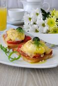 Eggs Benedict With Ham And Tomato On Toast With Cheese