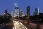 stock photo of texas  - Houston Skyline at Night with Moving Traffic - JPG