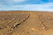 foto of dirt road  - Iceland Dirt Road through Stone Field - JPG