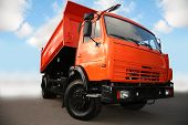 foto of dump_truck  - The truck on a cloudy sky background - JPG