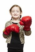 Young Girl Wearing Boxing Gloves Smiling