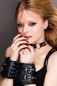 stock photo of sadist  - portrait of a passionate young woman in handcuffs - JPG