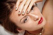 Portrait Of Attractive Girl With Beautiful Spiral Minx Nails