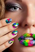 foto of minx  - Half face of attractive girl with beautiful multicolor holographic Minx nails and bright colorful make - JPG