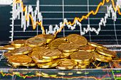 Golden Coins And Financial Chart As  Background