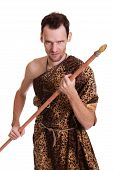 pic of beast-man  - Aggressive man as a savage hunter in skin of a beast with spear isolated on white background - JPG