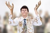 stock photo of repentance  - Young man raising dirty hands to heaven - JPG