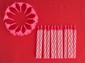 Birthday Cake Candles, Unlit On Red Serviette Aka Napkin Background