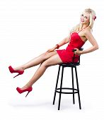 Pinup Girl Relaxing On A Bar Stool