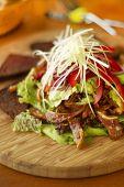 Salad with fried pork ears