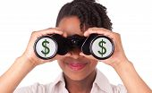 Young Black / African  American Business Woman Using Binoculars Reflecting Dollar Sign
