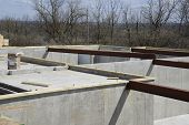 Concrete Foundation With Steel Beams For The Floor Joist