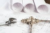 stock photo of mechanical drawing  - plumbing and drawings are on the desktop - JPG