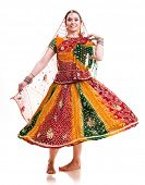 Bollywood dancer in traditional beautiful orange dress in movement