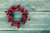 Christmas Wreath On A Wooden Background