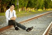 Man posing on railroad tracks